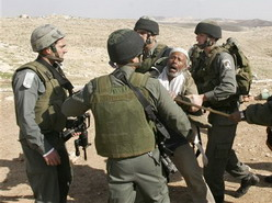 Border Police officers restraining a Bedouin man while his house is destroyed south of the West Bank city of Hebron on Wednesday Feb 14, 2007.