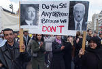 People carry banner with pictures of Ariel Sharon and Adolf Hitler during an anti-Israeli demonstration in central Amsterdam, Saturday, April 13, 2002. Thousands gathered to protest Israel's military actions in the West Bank. (AP Photo/Dusan Vranic)
